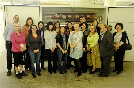 CMA members at the Hearst Museum's off-site storage facility. Back row, left to right: Jonathon Goodrich, Rachel Wright, Rachel Roy, Diana Marsh, Laurel Kendall, Alex de Voogt, Catherine Nichols, Trish Capone. Front row, left to right: Karen Quail, Megan Clagett, Cynthia Chavez Lamar, Jen Shannon, Jacklyn Lacey, Jennifer Kramer, Louise Hamby, Ira Jacknis, Trudy Nicks. Photo by Louise Hamby.